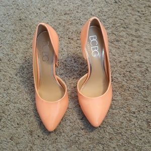 Peach colored patent leather pumps